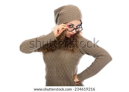 A girl in a gray sweater and glasses looking at the camera. Portrait of a beautiful young woman on a white background - stock photo