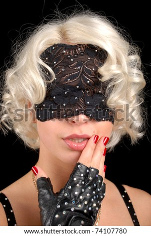 A girl in a sling on a black background. - stock photo