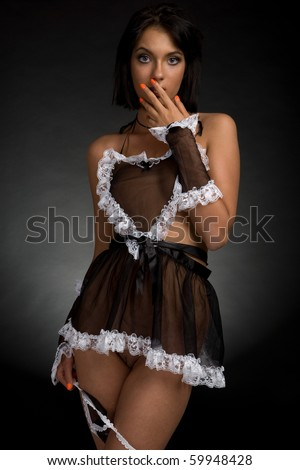 a girl in sexy apron - stock photo