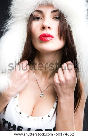 a girl in white fur hat - stock photo