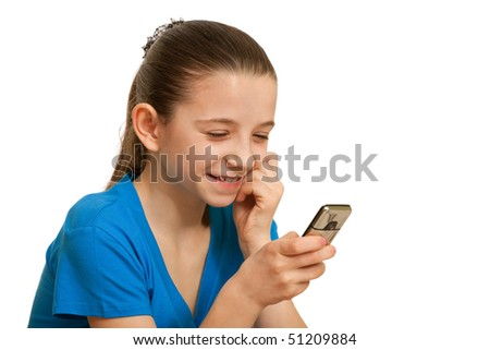 A girl is holding a mobile phone in her hand; isolated on the white background - stock photo