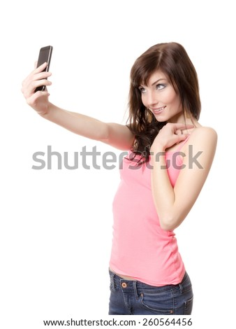 A girl is making a photograph of herself with a smartphone - stock photo