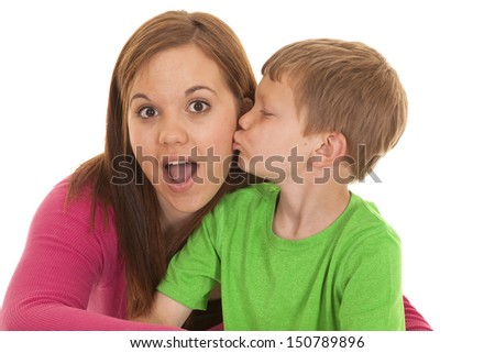 A girl is shocked that a young boy just kissed her. - stock photo