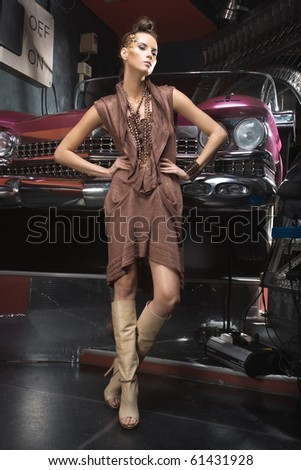 a girl near the grunge car - stock photo