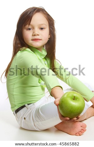 a girl offering a green apple