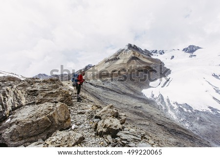 A girl on the rocky path in the Himalaya mountains, Nepal.