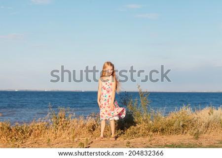 a girl on the seashore - stock photo