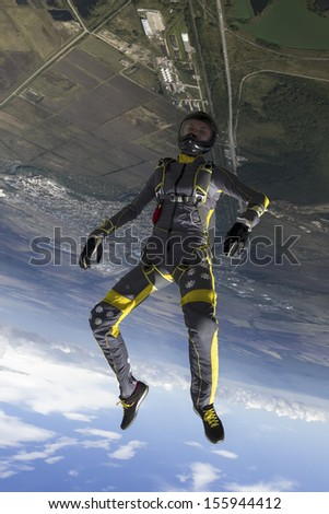 A girl performs in a free fall free style. - stock photo