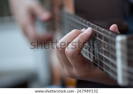 A girl playing guitar - stock photo