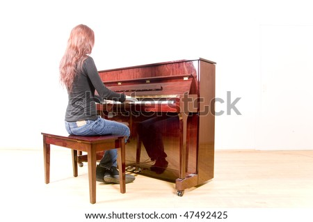 A girl playing the piano - stock photo