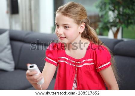 a girl playing video games - stock photo