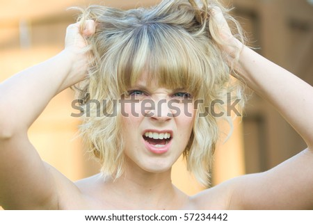 A girl pulling her hair - stock photo