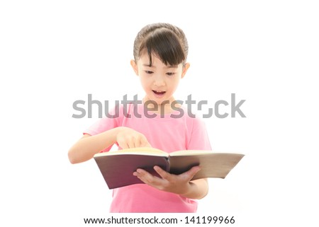 A girl reading her book - stock photo