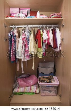 a girl's closet full of clothes
