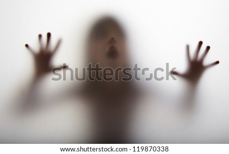 a girl  silhouette behind a  transparent  paper