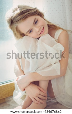 a girl sitting on a windowsill