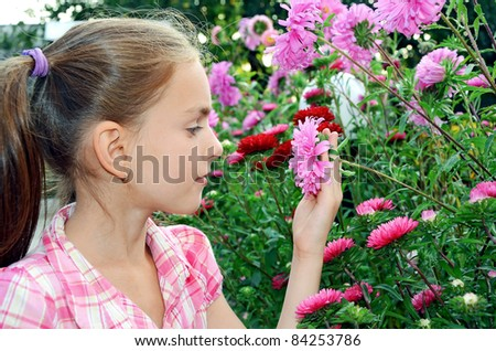 a girl smelling flowers - stock photo