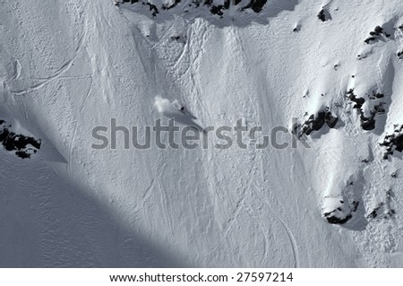 a girl snowboarder on a near vertical face during the 2009 extreme free-ride world championship finals - stock photo