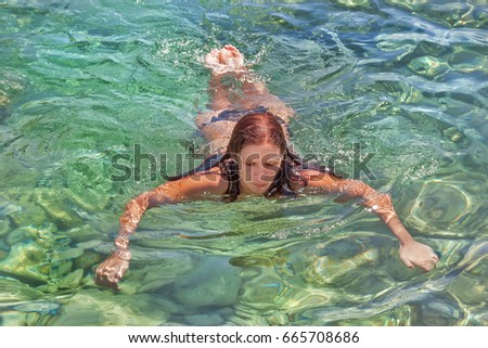 A girl swims in the Adriatic Sea