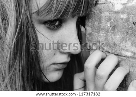 A girl teenager in the doldrums - stock photo