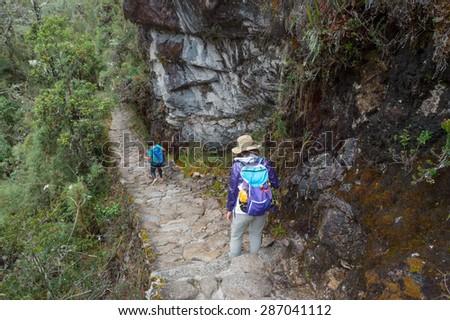 A Girl walking on The Inca Trail, Machu Picchu, Peru - stock photo