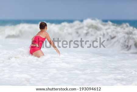 A girl was playing with big waves - stock photo