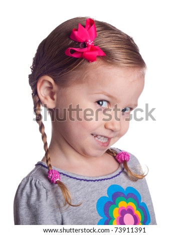 A girl who is excite to tell the viewer something.  The girl has cute pig tail braids. - stock photo