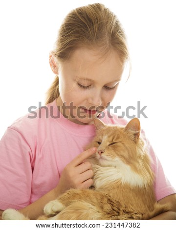 A girl with a cat in her arms on a white background.