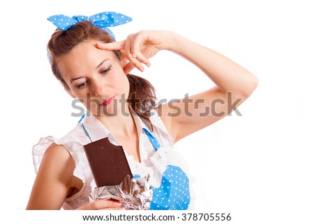 A girl with a chocolate bar in hand thinking about something, she holds a finger near the temple, a white background/The girl with a chocolate bar in hand/ A housewife with a chocolate bar