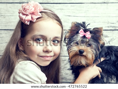 A girl with a dog. Closeup portrait