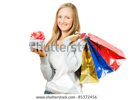 A girl with a gift and packages, white background - stock photo
