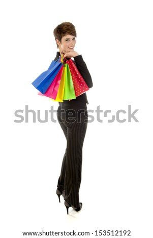 a girl with a lot of shopping bags in all kind of colors