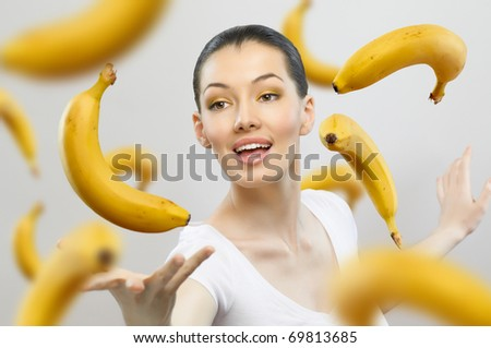 a girl with a ripe yellow banana - stock photo