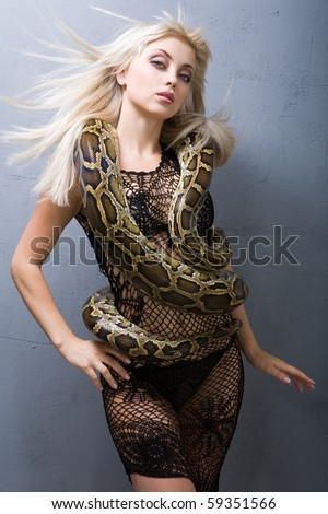 A girl with a snake - stock photo