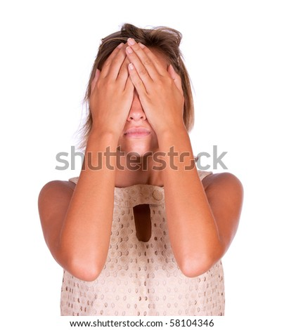 A girl with her hands covering her eyes. - stock photo