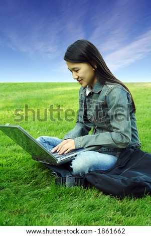 A girl with laptop working outdoor