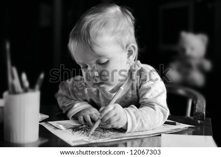 A girl with pencil drawing a picture