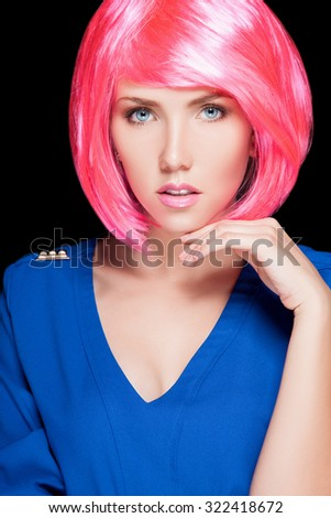 A girl with pink hair. The girl beautiful makeup and pink hair on her head. An attractive woman with blue eyes looking straight at the camera. Elegant woman of European appearance with pink hair - stock photo