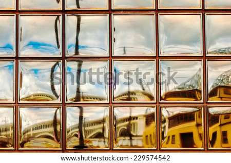 A glass-block window provides a painterly view of Cleveland's Flats district - stock photo