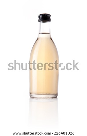 A glass bottle with orange soft drink reflective bottom isolated white.
