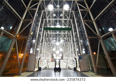 A glass building, Subway station entrance... The escalator with no-one, no body. Taiwan, Taipei - stock photo