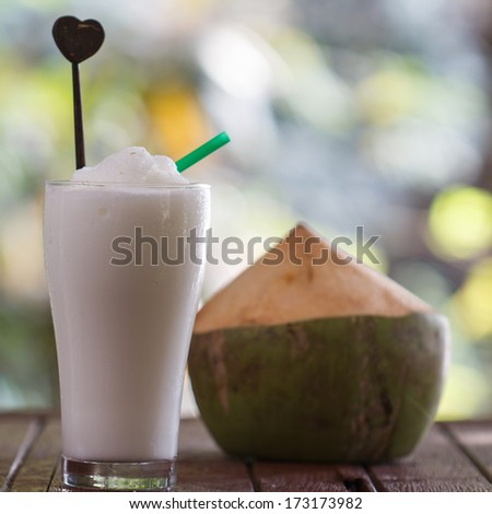 a glass cocktail of coconut milk ice smoothie, tropical fruit - stock photo