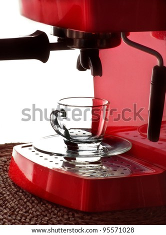 a glass cup and espresso machine