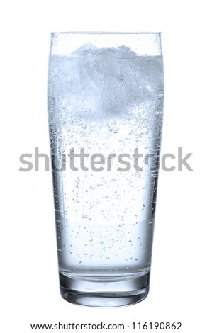 a glass filled with mineral water before white - stock photo