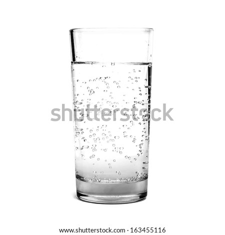 A glass filled with water isolated on a white background - stock photo