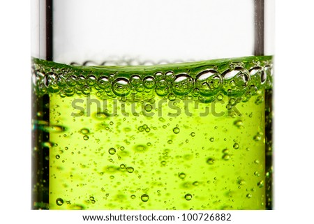 A glass flask with green liquid - stock photo
