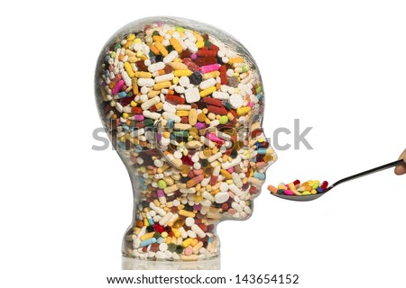 a glass head filled with many tablets. photo icon for drugs, abuse and addiction tablets. - stock photo