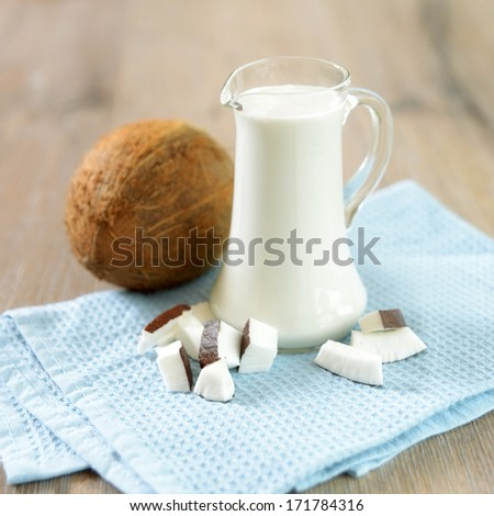 a glass jug with coconut milk - stock photo