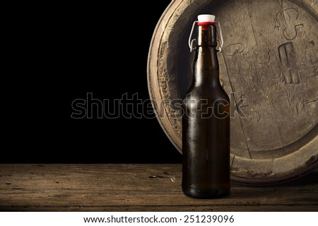A glass of beer in a barrel - stock photo