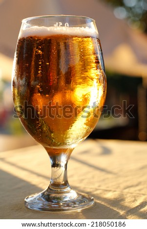 a glass of beer on a table - stock photo